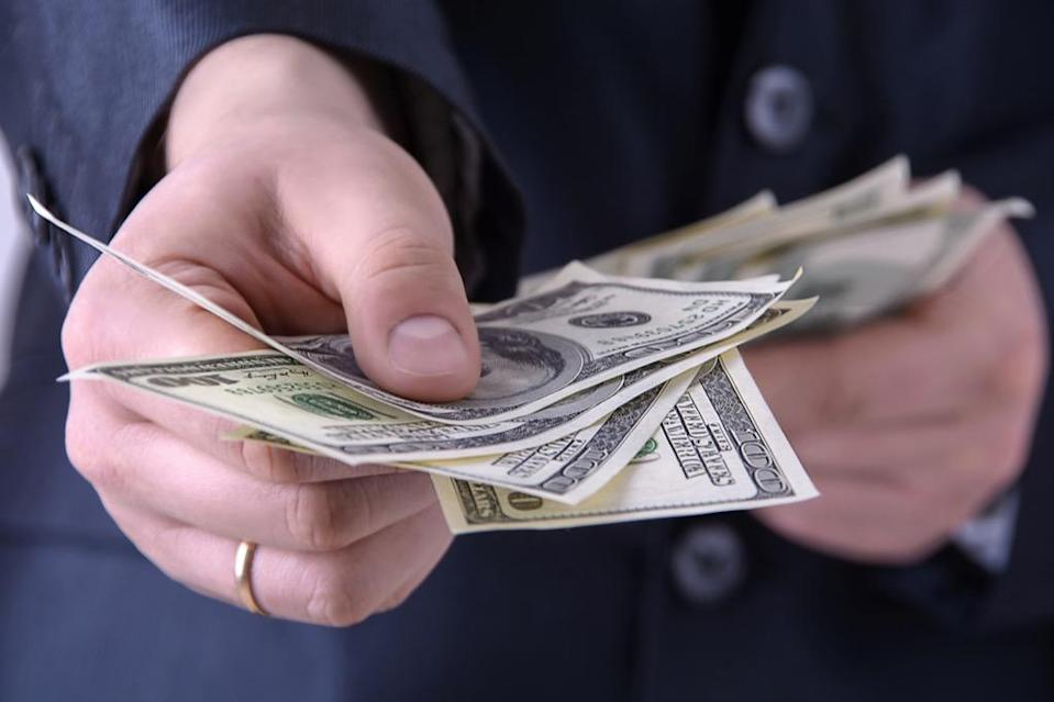 """We may call it """"paper money,"""" but the <a href=""""https://www.moneyfactory.gov/hmimpaperandink.html"""" rel=""""nofollow noopener"""" target=""""_blank"""" data-ylk=""""slk:currency is actually composed"""" class=""""link rapid-noclick-resp"""">currency is actually composed</a> of 75 percent cotton and 25 percent linen. According to the Treasury's Bureau of Engraving and Printing, that material is delivered (with the exception of what's used for $100 bills) in loads of 20,000 sheets that are each painstakingly tracked. The various colors of ink used are mixed specially by the Bureau for reasons of security."""