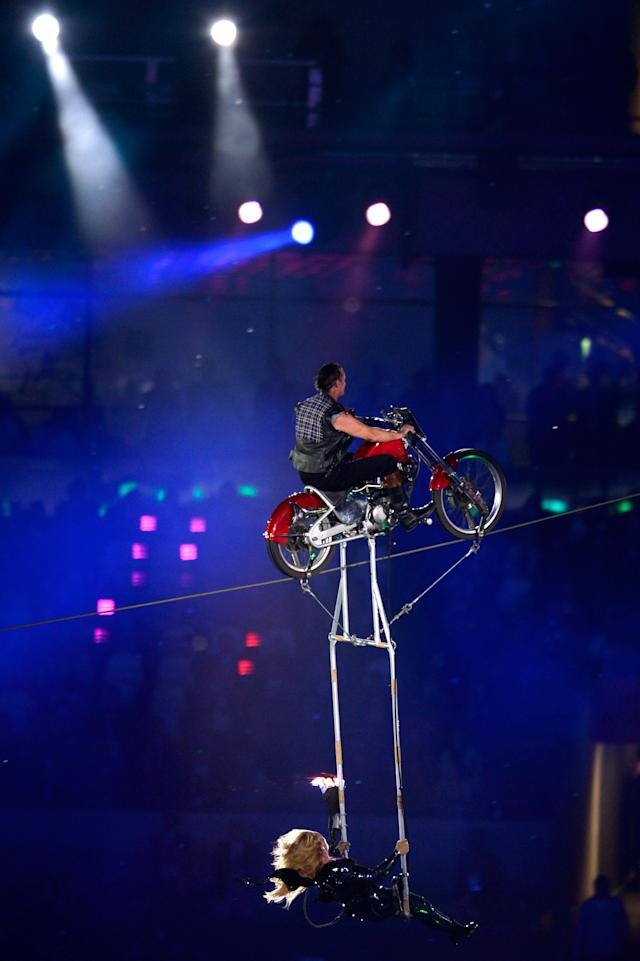 LONDON, ENGLAND - SEPTEMBER 09: Circus artists perform using a motorcycle during the closing ceremony on day 11 of the London 2012 Paralympic Games at Olympic Stadium on September 9, 2012 in London, England. (Photo by Dennis Grombkowski/Getty Images)