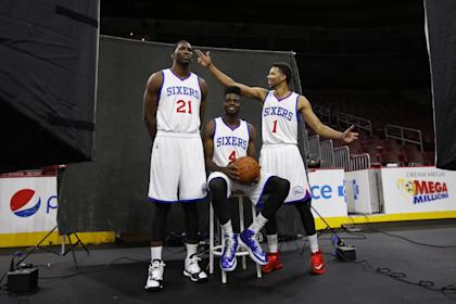 Of Sam Hinkie's top three draft picks, only Nerlens Noel (center) remains a contributor in Philly. (AP)
