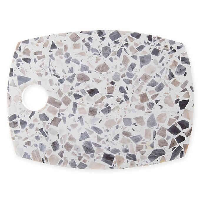 <p>The <span>Artisanal Kitchen Supply Terrazzo 12-Inch Cheese Board</span> ($15) may encourage them to invite you over for more wine and cheese!</p>