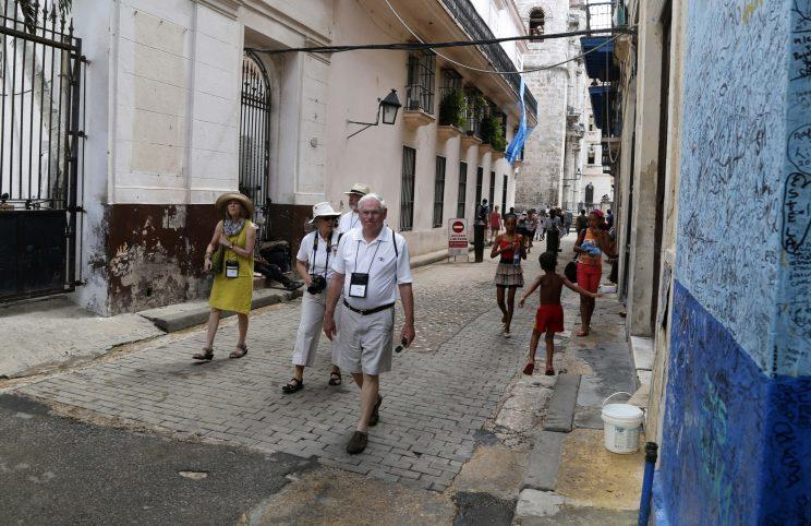 Tourists walk in Havana, Cuba