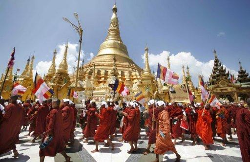 <p>Buddhist monks march down a street in protest in Yangon in September 2007. A leader of Myanmar's 2007 monk rallies has been arrested, an official said Tuesday, in his latest brush with the law since being freed from jail along with hundreds of other political prisoners this year.</p>