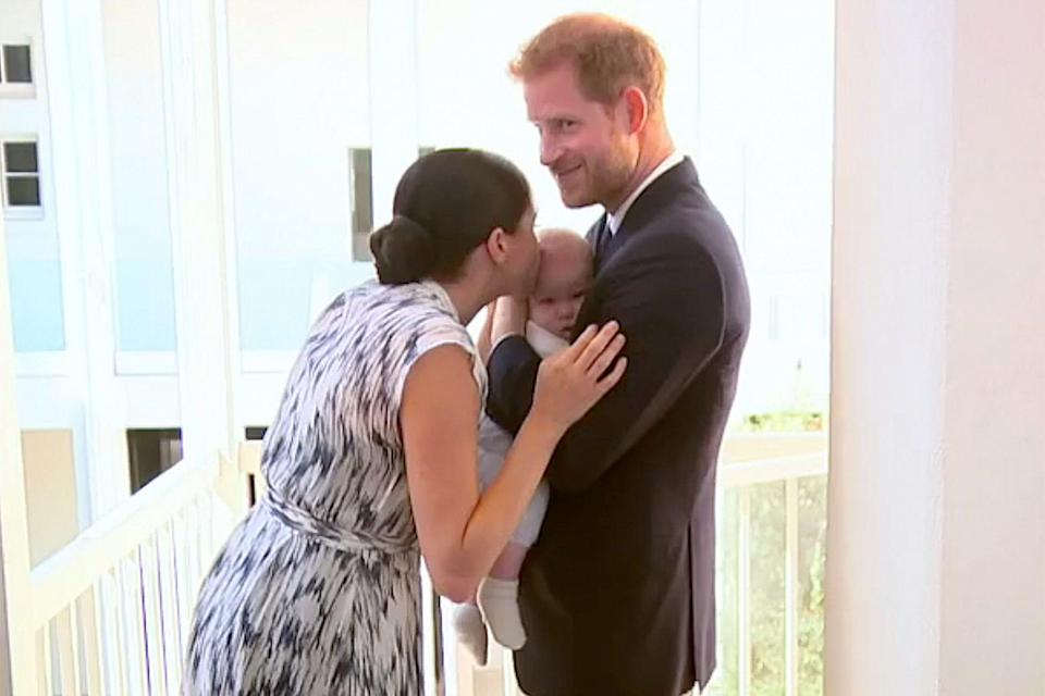 """<p>Archie also got a smooch from his royal mom on the same trip. """"""""He's an old soul!"""" <a href=""""https://people.com/royals/everything-meghan-markle-and-prince-harry-have-said-about-archie-during-royal-tour-in-africa/?slide=7317527#7317527"""" rel=""""nofollow noopener"""" target=""""_blank"""" data-ylk=""""slk:Meghan shared with onlookers"""" class=""""link rapid-noclick-resp"""">Meghan shared with onlookers</a>.</p>"""