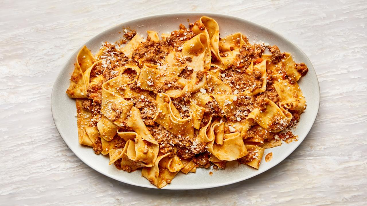 """It doesn't take a lot of ingredients (or a lot of money) to make a classic Bolognese recipe. What it does take, though, is patience for the sauce to achieve the ideal authentic texture. You're going to go low and slow—it'll take around 3 hours, but most of that cook time is hands-off. This is part of <a href=""""http://www.bonappetit.com/best?mbid=synd_yahoo_rss"""">BA's Best</a>, a collection of our essential recipes. <a href=""""https://www.bonappetit.com/recipe/bas-best-bolognese?mbid=synd_yahoo_rss"""">See recipe.</a>"""