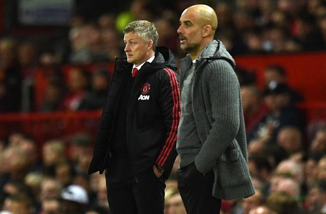 Manchester United manager Ole Gunnar Solskjaer (left) and Manchester City boss Pep Guardiola pictured at Old Trafford (AFP Photo/Oli SCARFF )