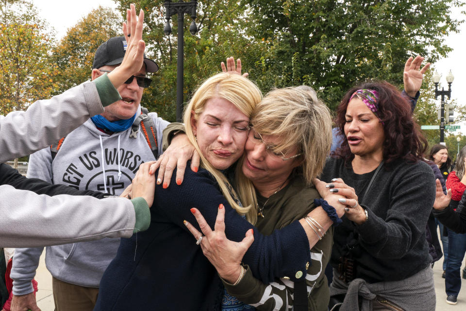 Christians hug while praying in support of Supreme Court nominee Amy Coney Barrett, Monday, Oct. 26, 2020, outside the Supreme Court on Capitol Hill in Washington. (AP Photo/Jacquelyn Martin)