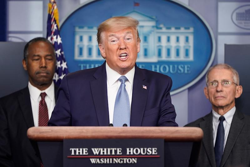 President Trump with Ben Carson, secretary of Housing and Urban Development, left, and Dr. Anthony Fauci, director of the National Institute of Allergy and Infectious Diseases Anthony Fauci. (Joshua Roberts/Reuters)