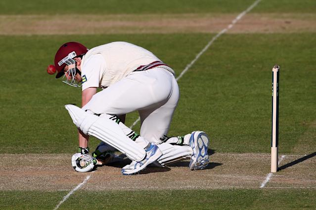 TAUNTON, ENGLAND - APRIL 14: Chris Jones of Somerset is hit on the helmet by a delivery from Liam Plunkett of Yorkshire during day two of the LV County Championship match between Somerset and Yorkshire at The County Ground on April 14, 2014 in Taunton, England. (Photo by Michael Steele/Getty Images)