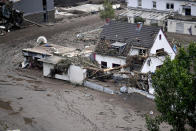 A road is covered with mud in Altenahr, western Germany, Saturday, July 17, 2021. Heavy rains caused mudslides and flooding in the western part of Germany. Multiple have died and are missing as severe flooding in Germany and Belgium turned streams and streets into raging, debris-filled torrents that swept away cars and toppled houses. (Lino Mirgeler/dpa via AP)