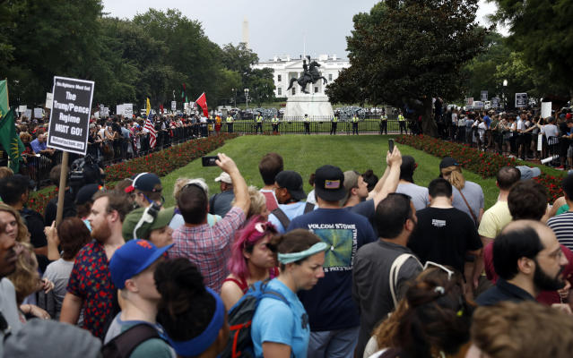 <p>Demonstrators march near the White House on the one year anniversary of the Charlottesville 'Unite the Right' rally, Sunday, Aug. 12, 2018, in Washington. (AP Photo/Jacquelyn Martin) </p>