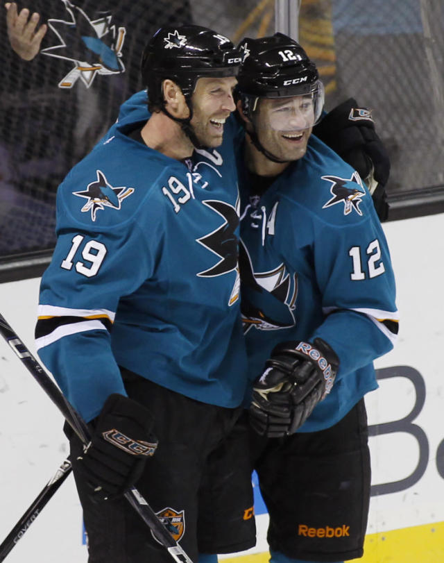 San Jose Sharks' Patrick Marleau, right, celebrates with Joe Thornton after scoring a goal against the Anaheim Ducks during the second period of an NHL hockey game, Saturday, Nov. 30, 2013, in San Jose, Calif. (AP Photo/George Nikitin)