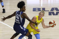 Chicago Sky guard Courtney Vandersloot (22) looks to pass around Minnesota Lynx guard Shenise Johnson (42) during the second half of a WNBA basketball game Thursday, July 30, 2020, in Bradenton, Fla. (AP Photo/Chris O'Meara)
