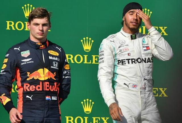 Lewis Hamilton (right) paid respect to Max Verstappen after their duel in the Hungarian GP (AFP Photo/Attila KISBENEDEK)
