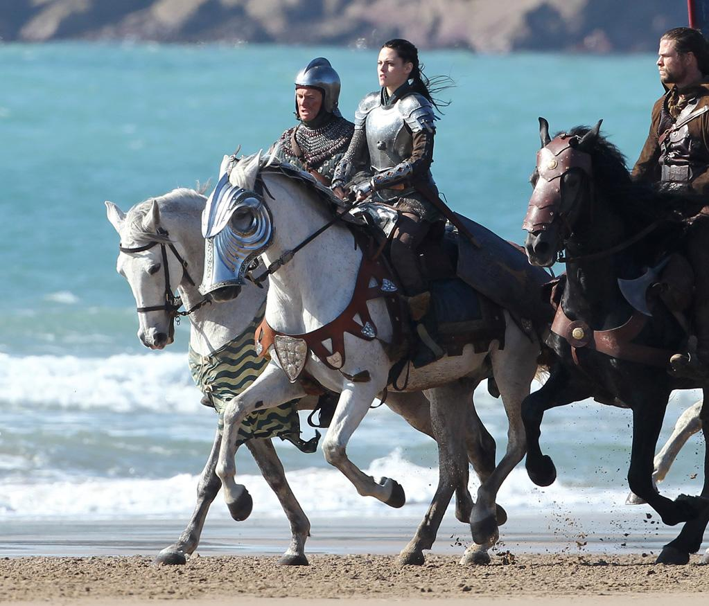 """Kristen Stewart and Chris Hemsworth got all armored up on the set of """"Snow White and the Huntsman"""" while shooting on a beach in Wales on Wednesday. The fantasy film will hit theaters next June. Tilak Desai/<a href=""""http://www.splashnewsonline.com"""" target=""""new"""">Splash News</a> - September 28, 2011"""