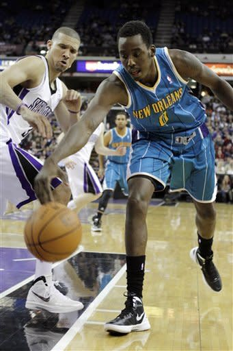 New Orleans Hornets forward Al-Farouq Aminu (0) reaches for the ball ahead of Sacramento Kings forward Francisco Garcia during the second quarter of an NBA basketball game in Sacramento, Calif., Wednesday, March 7, 2012. (AP Photo/Rich Pedroncelli)