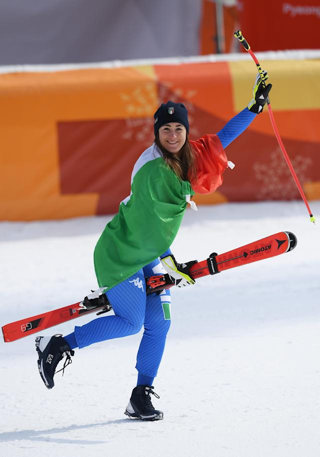 <p>Gold medallist Sofia Goggia of Italy celebrates during the victory ceremony for the Ladies' Downhill on day 12 of the PyeongChang 2018 Winter Olympic Games at Jeongseon Alpine Centre on February 21, 2018 in Pyeongchang-gun, South Korea. (Photo by Matthias Hangst/Getty Images) </p>