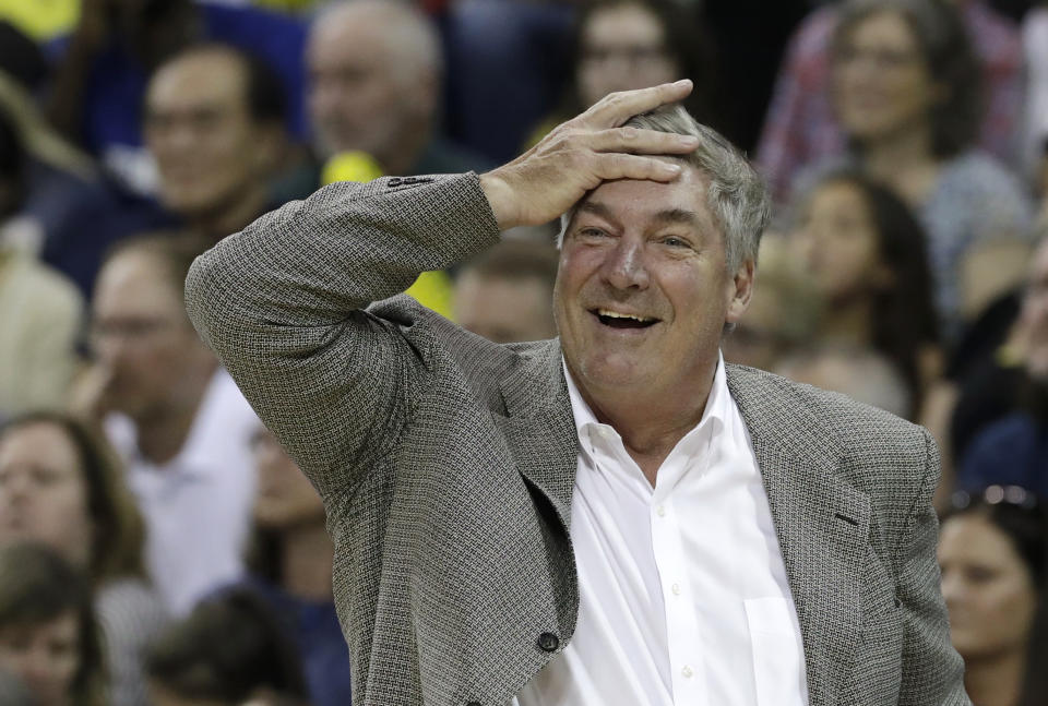 Bill Laimbeer reacts after a foul call by putting his hand to his forehead in an exasperated laugh.