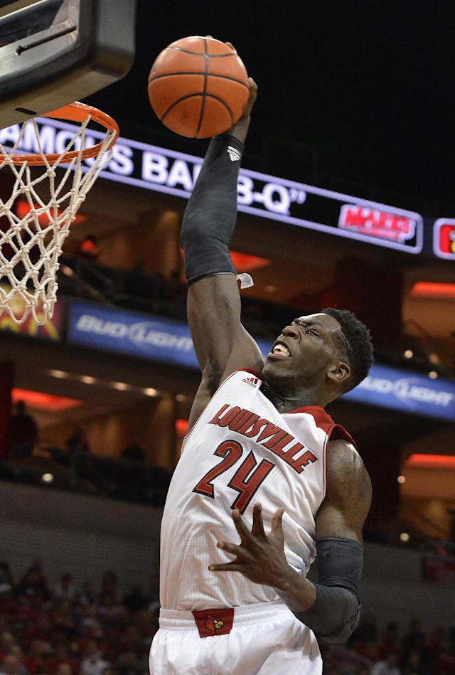 Louisville's Montrezl Harrell goes up for a dunk during the NCAA college basketball team's scrimmage Saturday, Oct. 5, 2013, in Louisville, Ky. (AP Photo/Timothy D. Easley)