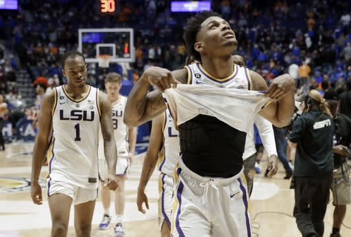 LSU guard Marlon Taylor, right, and guard Javonte Smart (1) walk off the court after losing to Florida in an NCAA college basketball game at the Southeastern Conference tournament Friday, March 15, 2019, in Nashville, Tenn. Florida won 76-73. (AP Photo/Mark Humphrey)
