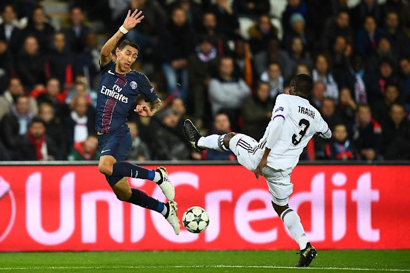 Paris Saint-Germain's Angel Di Maria (L) challenges Basel's Adama Traore during their UEFA Champions League Group A match, at the Parc des Princes stadium in Paris, on October 19, 2016