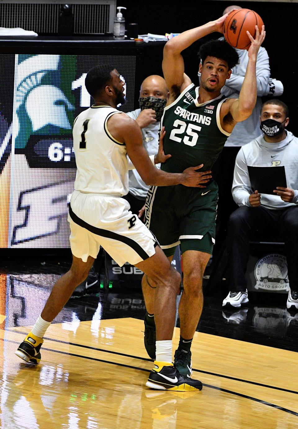 Feb 16, 2021; West Lafayette, Indiana, USA;  Michigan State Spartans forward Malik Hall (25) looks to get the ball away from Purdue Boilermakers forward Aaron Wheeler (1) during the first half of the game at Mackey Arena. Mandatory Credit: Marc Lebryk-USA TODAY Sports