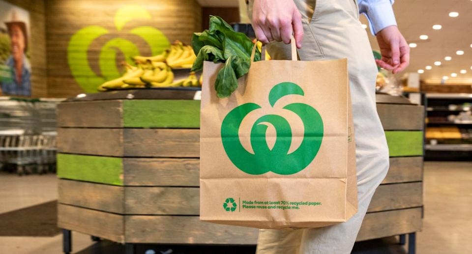 Picture of a customer holding a new paper bag, which Woolworths launched this week.