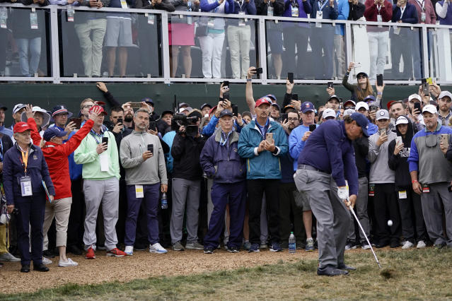 Phil Mickelson hits from the rough on the 18th hole during the second round of the U.S. Open golf tournament Friday, June 14, 2019, in Pebble Beach, Calif. (AP Photo/David J. Phillip)