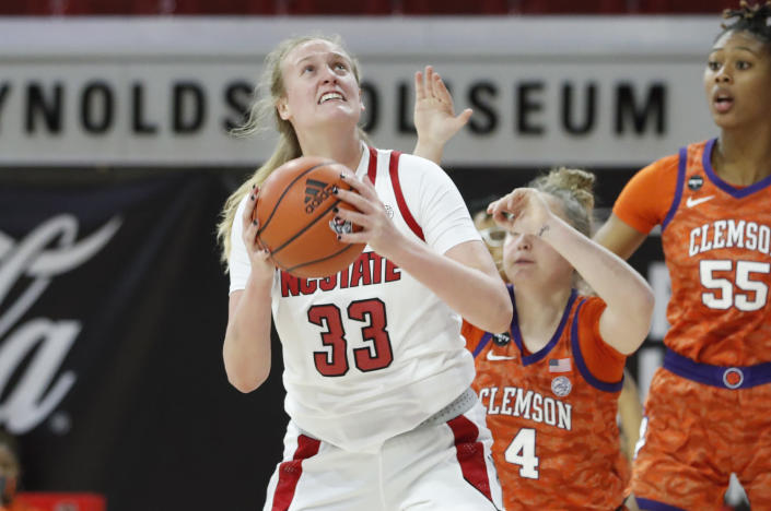 North Carolina State's Elissa Cunane (33) prepares to shoot against Clemson during the first half of an NCAA college basketball game at Reynolds Coliseum in Raleigh, N.C., Thursday, Feb. 11, 2021. (Ethan Hyman/The News & Observer via AP)