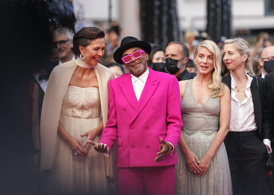 FILE - In this July 6, 2021 file photo Jury president Spike Lee, second from left, poses with jury members Maggie Gyllenhaal, from left, Melanie Laurent and Jessica Hausner at the premiere of the film 'Annette' and the opening ceremony of the 74th international film festival, Cannes, southern France, Tuesday, July 6, 2021. (AP Photo/Brynn Anderson, File)