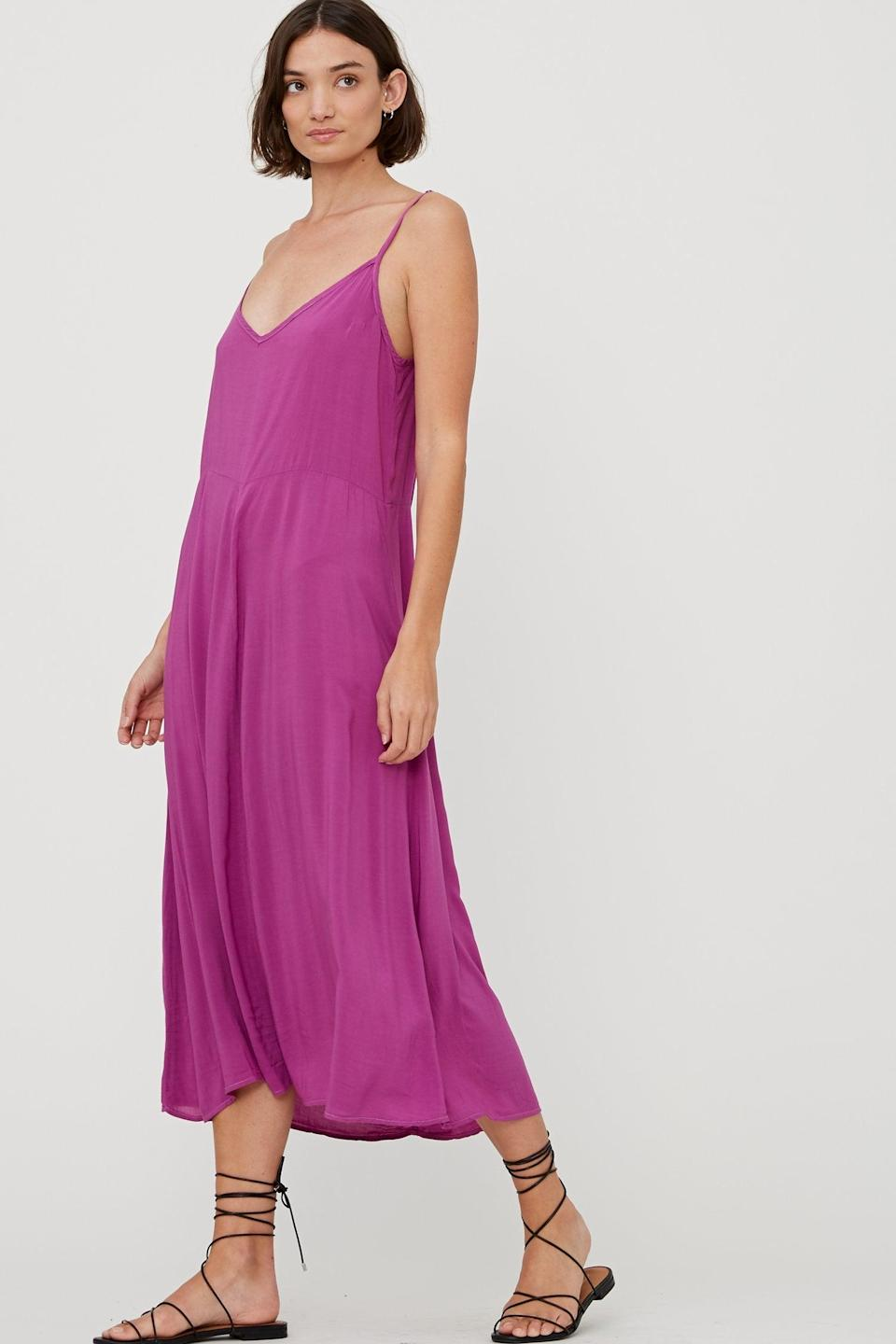 """<h2>Lacausa Stevie Slipdress</h2><br>Contrary to popular belief, the slipdress is a surprisingly versatile year-round frock. While you'll wear it all by its lonesome in the sweltering summer months, it's an easy-to-layer fall staple that can be thrown over a turtleneck, bodysuit, or leggings when the weather cools. We love this eye-catching option from California-based Lacausa, an indie brand that manufactures locally and makes <a href=""""https://www.lacausaclothing.com/pages/our-cause"""" rel=""""nofollow noopener"""" target=""""_blank"""" data-ylk=""""slk:regular donations to organizations"""" class=""""link rapid-noclick-resp"""">regular donations to organizations</a> like Black Lives Matter, Baby2Baby, and the Los Angeles Food Bank.<br><br><strong>Lacausa</strong> Stevie Slipdress, $, available at <a href=""""https://go.skimresources.com/?id=30283X879131&url=https%3A%2F%2Fwww.lacausaclothing.com%2Fcollections%2Funder-100%2Fproducts%2Fstevie-slip-fuschia"""" rel=""""nofollow noopener"""" target=""""_blank"""" data-ylk=""""slk:LACAUSA"""" class=""""link rapid-noclick-resp"""">LACAUSA</a>"""