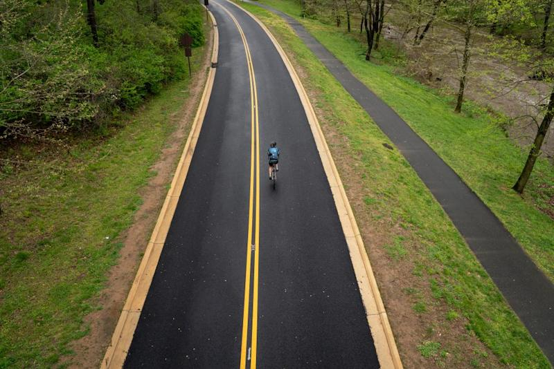 A cyclist rides along Beach Drive in Washington DC in April. The city closed portions of the road to vehicular traffic during the coronavirus outbreak.