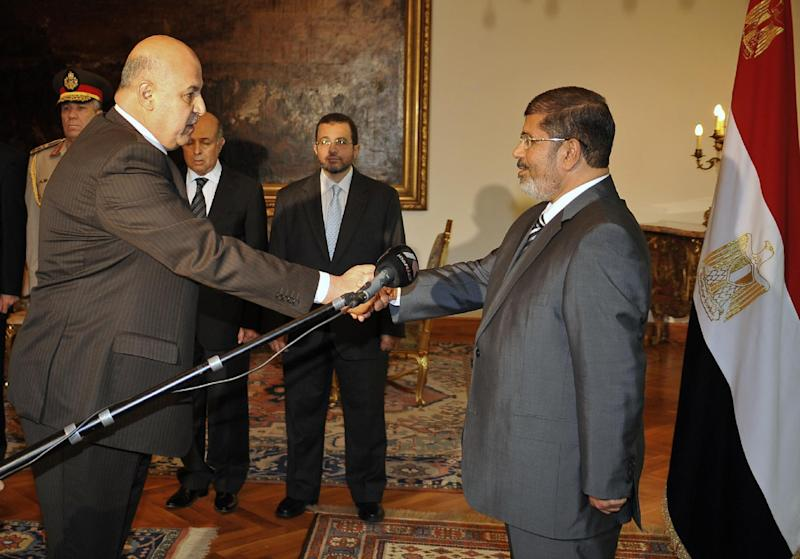RETRANSMISSION FOR ALTERNATIVE CROP - Egyptian President Mohammed Morsi swears in newly-appointed vice president, a former senior judge, Mahmoud Mekki, in Cairo, Egypt, Sunday, Aug. 12, 2012. Egypt's Islamist president ordered his defense minister and chief of staff to retire on Sunday and canceled the military-declared constitutional amendments that gave top generals wide powers. (AP Photo/Egyptian Presidency)