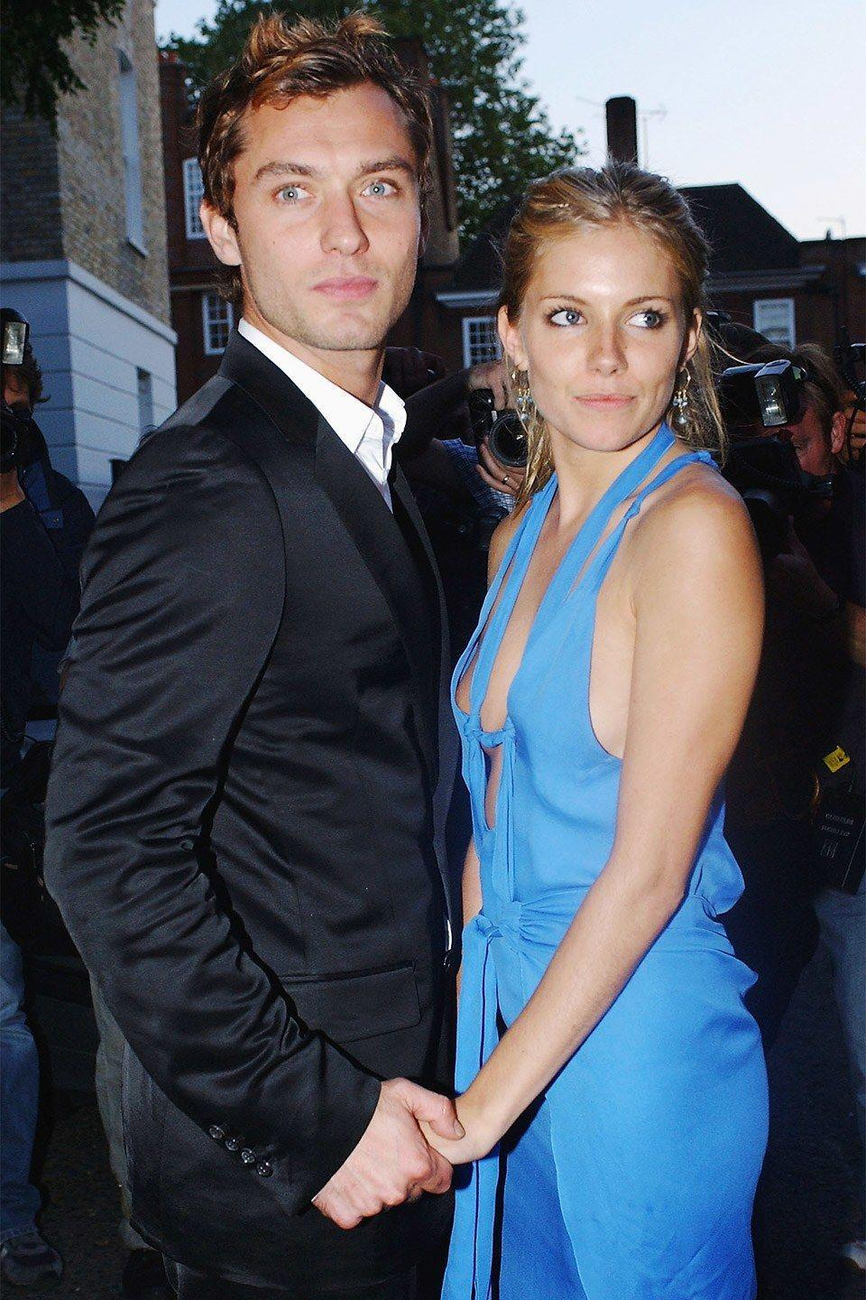 """<p>The actors met on the set of <em>Alfie </em><span class=""""redactor-invisible-space"""">in 2004 and took their romance off-screen, getting engaged on Christmas Day of that year. In July 2005, Law admitted to having an affair with the nanny of his children and the couple <a href=""""http://people.com/celebrity/jude-law-and-sienna-miller-call-it-quits/"""" rel=""""nofollow noopener"""" target=""""_blank"""" data-ylk=""""slk:split up"""" class=""""link rapid-noclick-resp"""">split up</a> in 2006. </span></p>"""