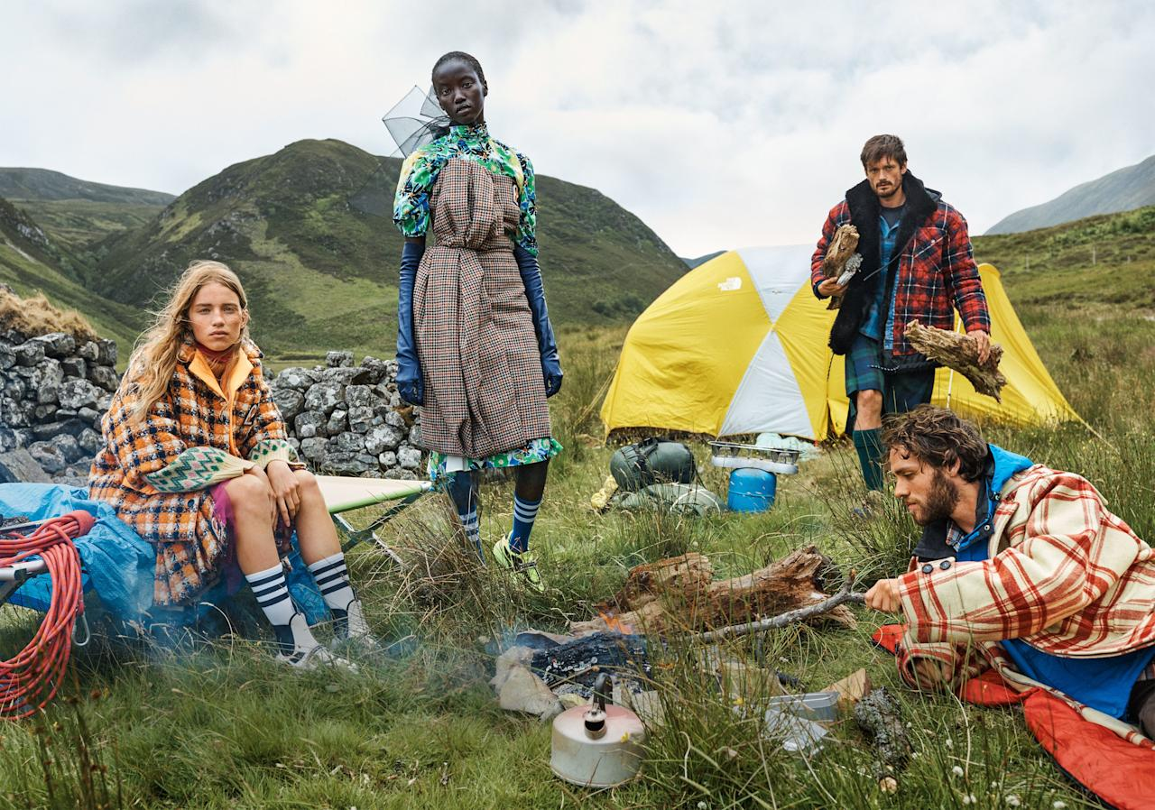When in Scotland (here, just beyond Inverness at the Alladale Wilderness Reserve), roughing it with tartan is a way of life. From left: Model Rebecca Leigh wears a Prada coat, $2,200; select Prada stores. Model Anok Yai wears a Prada top ($1,060) and skirt ($2,340); select Prada stores. Documentarian and writer Leon McCarron wears a Balenciaga jacket. Zoologist-adventurer Luca Bortali wears a Marni coat.<br> <em>Fashion Editor: Lucinda Chambers.</em>