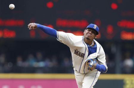 Jun 3, 2018; Seattle, WA, USA; Seattle Mariners starting pitcher Felix Hernandez (34) throws out a pitch against the Tampa Bay Rays during the first inning at Safeco Field. Mandatory Credit: Jennifer Buchanan-USA TODAY Sports