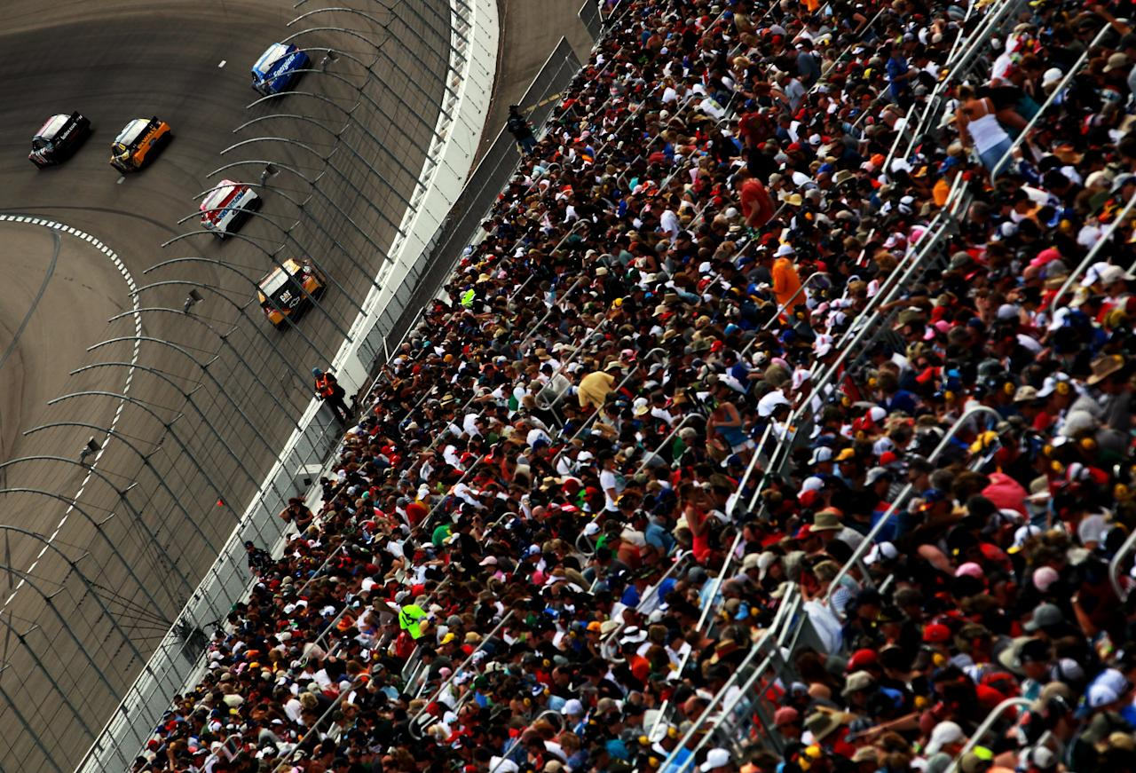 LAS VEGAS, NV - MARCH 11:  Denny Hamlin, driver of the #11 FedEx Freight Toyota, leads a group of cars during the NASCAR Sprint Cup Series Kobalt Tools 400 at Las Vegas Motor Speedway on March 11, 2012 in Las Vegas, Nevada.  (Photo by Ronald Martinez/Getty Images for NASCAR)