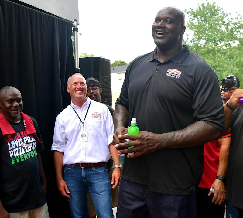 Papa John's then-CEO Steve Ritchie and Shaquille O'Neal attend Shaq's Papa John's Pizza Grand Opening on Aug. 24, 2019 in Atlanta, Georgia. (Prince Williams/Wireimage)
