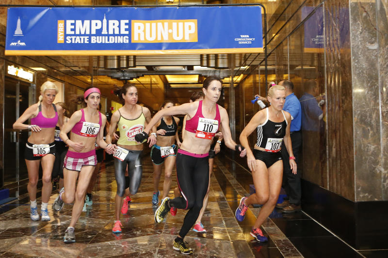 Australia's Suzy Walsham (110) and New Zealand's Melissa Moon (107) lead the women's division as they sprint for the stairs at the start of the Empire State Building Run-Up Wednesday, Feb. 5, 2014, in New York. Walsham won the race. (AP Photo/Jason DeCrow)