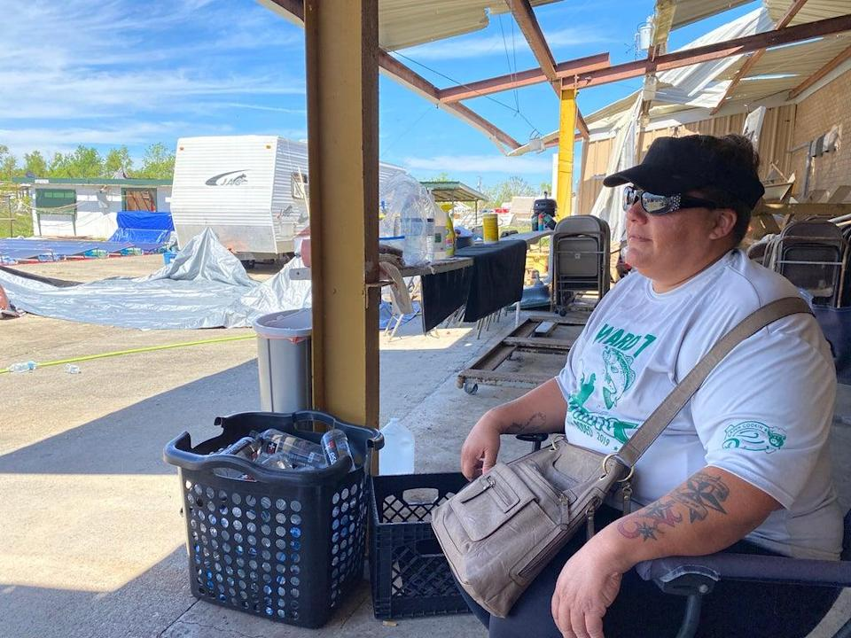 Keisha Foret sits in the parking lot of the Ward 7 Citizens Club in Chauvin, Louisiana. She lives in a camper there after her home was destroyed in Hurricane Ida. (Alex Woodward)