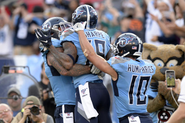 Tennessee Titans wide receiver Tajae Sharpe (19) celebrates with Adam Humphries (10) and Taylor Lewan, left, after Sharpe scored a touchdown against the Los Angeles Chargers in the second half of an NFL football game Sunday, Oct. 20, 2019, in Nashville, Tenn. (AP Photo/Mark Zaleski)