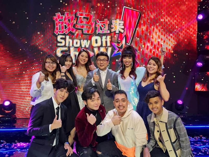 """Jack Neo poses with the winners of """"Show off Show""""."""