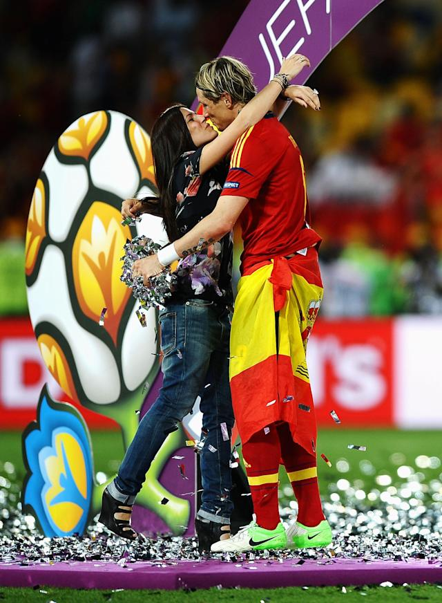 KIEV, UKRAINE - JULY 01: Fernando Torres of Spain kisses his wife Olalla Dominguez on the picth following victory in the UEFA EURO 2012 final match between Spain and Italy at the Olympic Stadium on July 1, 2012 in Kiev, Ukraine. (Photo by Laurence Griffiths/Getty Images)