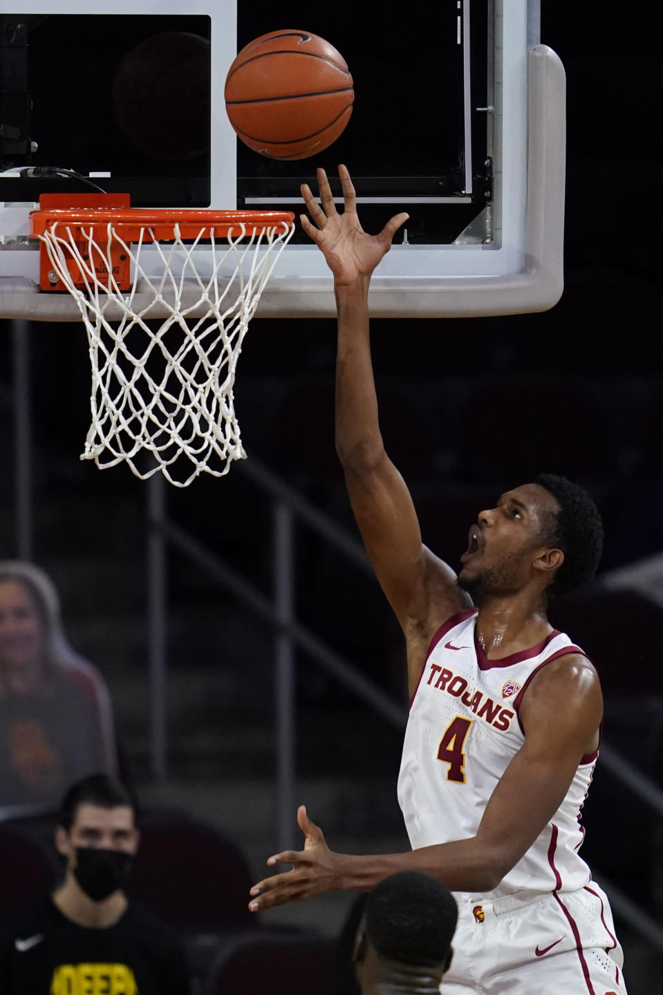 Southern California forward Evan Mobley (4) shoots during the first half of an NCAA college basketball game against Oregon Monday, Feb. 22, 2021, in Los Angeles. (AP Photo/Ashley Landis)