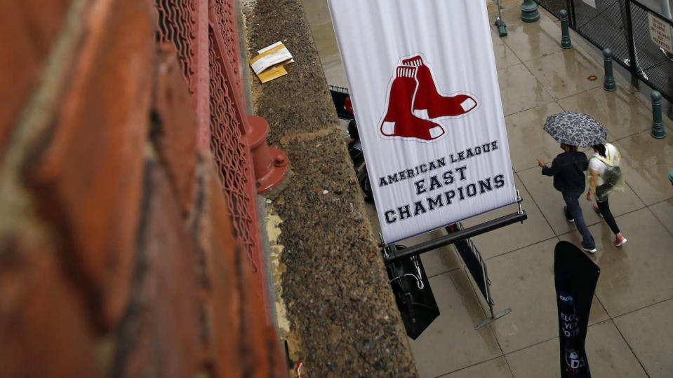 The Red Sox hung this banner outside Fenway Park after clinching last year's American League East title. (AP)