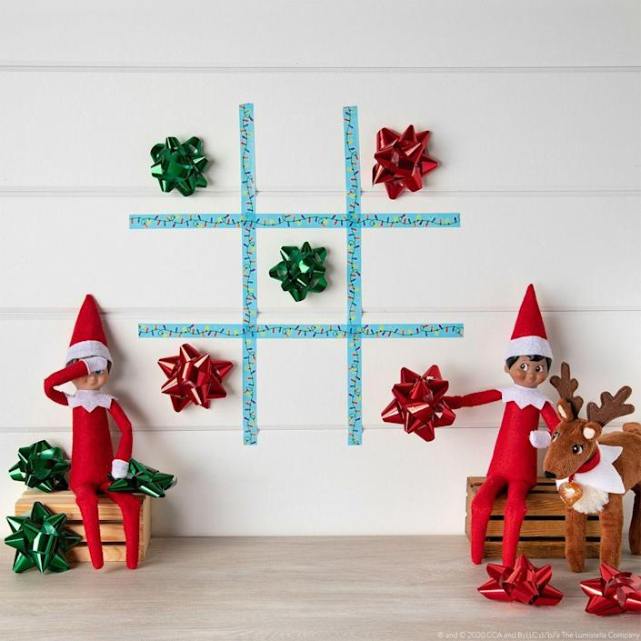 """<p>You've heard of """"Tic Tac Toe,"""" but what about """"Tic Tac Bow""""? It's the Christmas-ified version of the classic game, and Scout Elves <em>love</em> it.</p><p><strong>Get the tutorial at <a href=""""https://elfontheshelf.com/elf-ideas/tic-tac-bow"""" rel=""""nofollow noopener"""" target=""""_blank"""" data-ylk=""""slk:Elf on the Shelf"""" class=""""link rapid-noclick-resp"""">Elf on the Shelf</a>.</strong> </p>"""