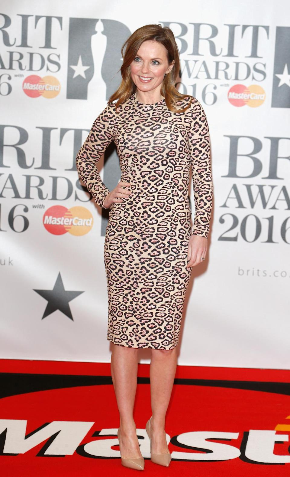 <p>The former Spice Girl opted for a figure-hugging and eye-catching leopard print dress. <i>[Photo: Getty]</i></p>