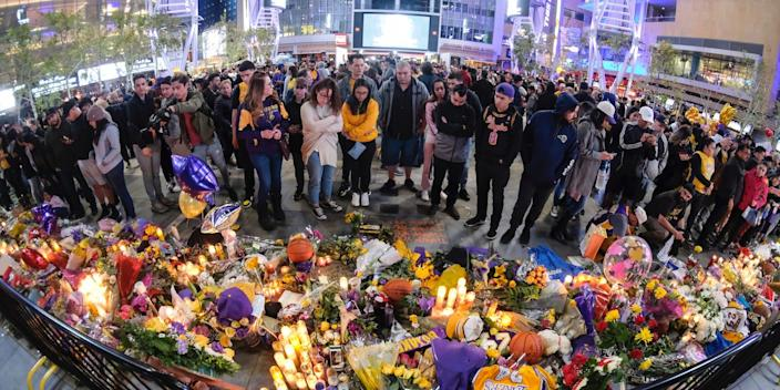 Fans gathering at a memorial for Kobe Bryant outside the Staples Center.