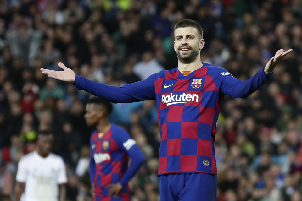 Barcelona's Gerard Pique reacts during the Spanish La Liga soccer match between Real Madrid and Barcelona at the Santiago Bernabeu stadium in Madrid, Spain, Sunday, March 1, 2020. (AP Photo/Manu Fernandez)