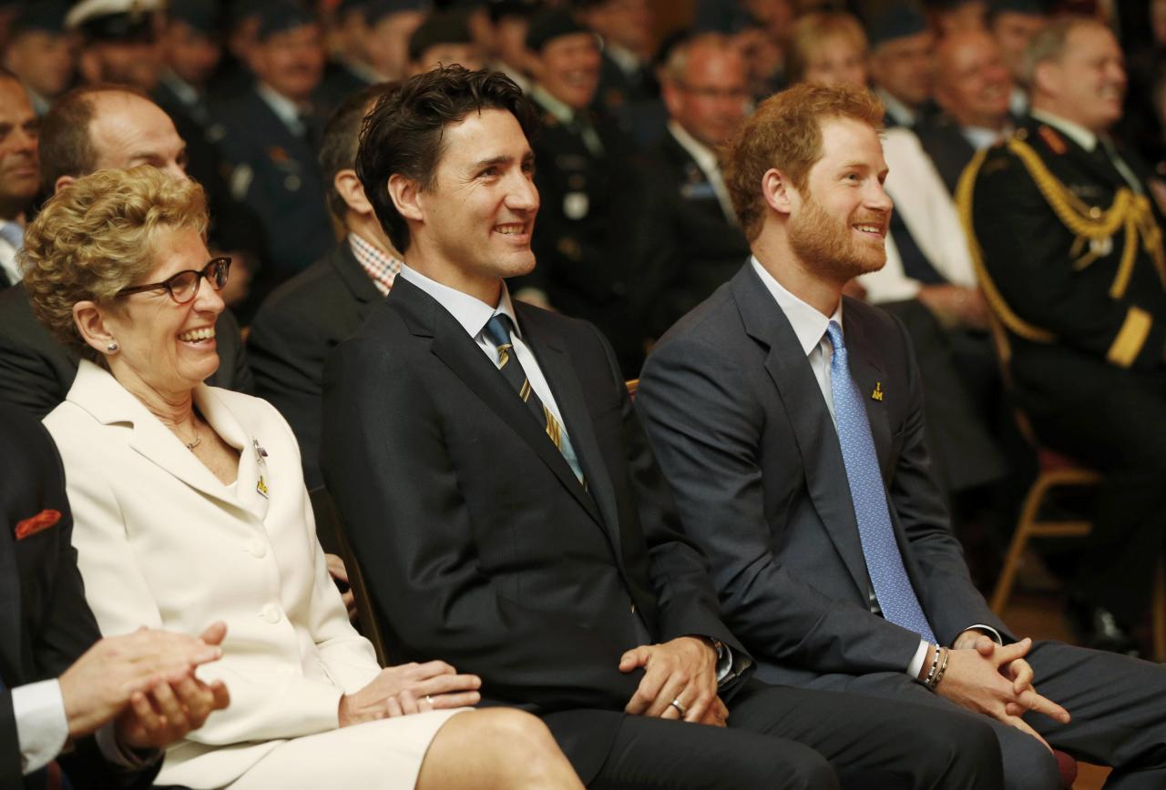 Ontario Premier Kathleen Wynne (L to R), Britain's Prince Harry and Canada's Prime Minister Justin Trudeau listen to opening remarks during a Invictus Games media launch in Toronto, Ontario, Canada, May 2, 2016. REUTERS/Mark Blinch