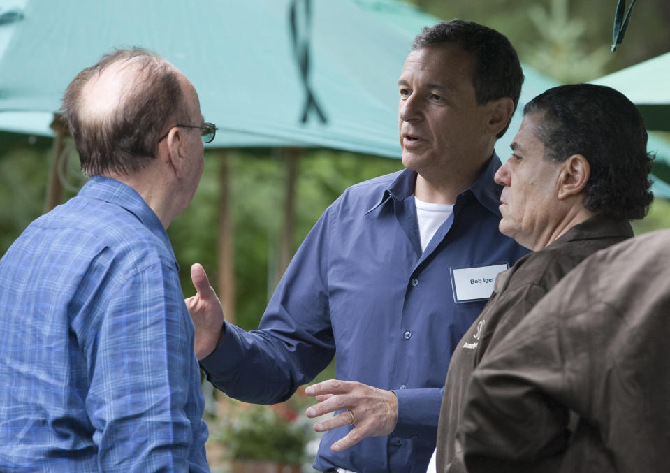News Corporation Chairman and CEO Rupert Murdoch, left, chats with Disney's Robert Iger, center, and Haim Saban, at the annual Allen & Co.'s media summit in Sun Valley, Idaho, Wednesday, July 8, 2009. (AP Photo/Nati Harnik)